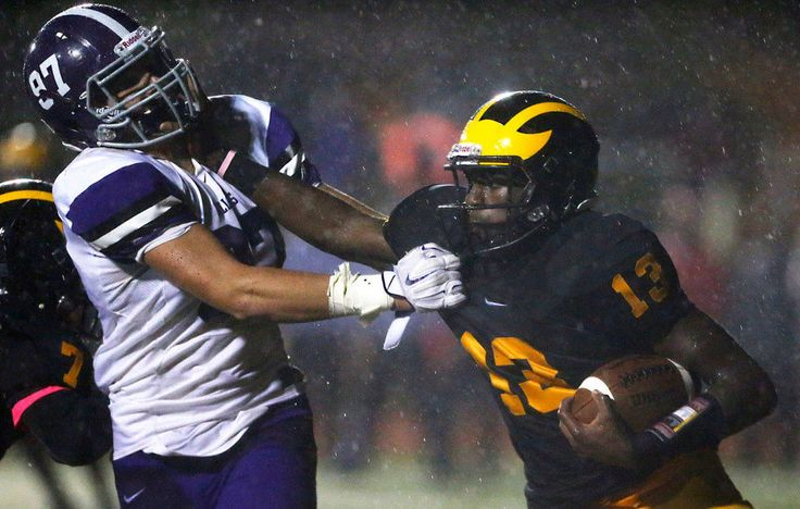 St. John Vianney quarterback Anthony Brown Jr. (13) is defended by Ian Clarke (97) of Rumson-Fair Haven as St. John Vianney tops Rumson-Fair Haven 13-6 at St. John Vianney High School in Holmdel , NJ 10/2/15 (Amanda Marzullo | NJ Advance Media for NJ.com)