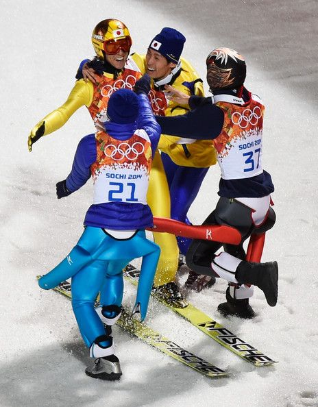 Silver medalist Noriaki Kasai of Japan (L) celebrates with Daiki Ito, Taku Takeuchi and Reruhi Shimizu of Japan after the Men's Large Hill I...