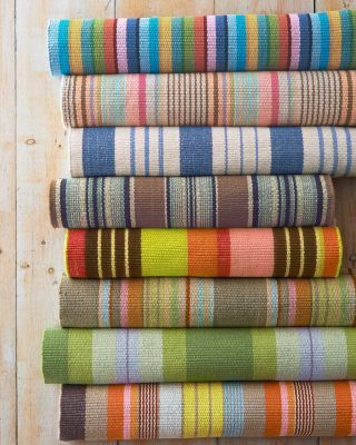 Reversible handwoven cotton rugs add a burst of brilliance to casual cottage decor. Made to mix and match in five distinctive striped patterns. Comes in 6 rectangular sizes, including runner. Colors: Tortola, Saranac, Nantucket, Framboise or Caravan.