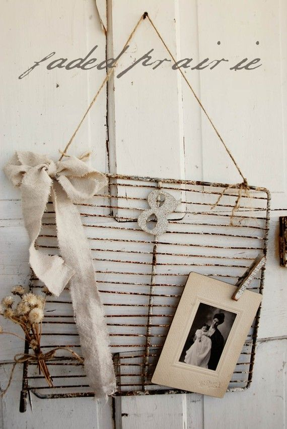 Turn an old oven rack into a rustic message/photo board.