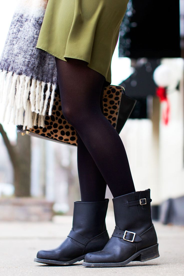 Frye booties paired with tights for a winter look.