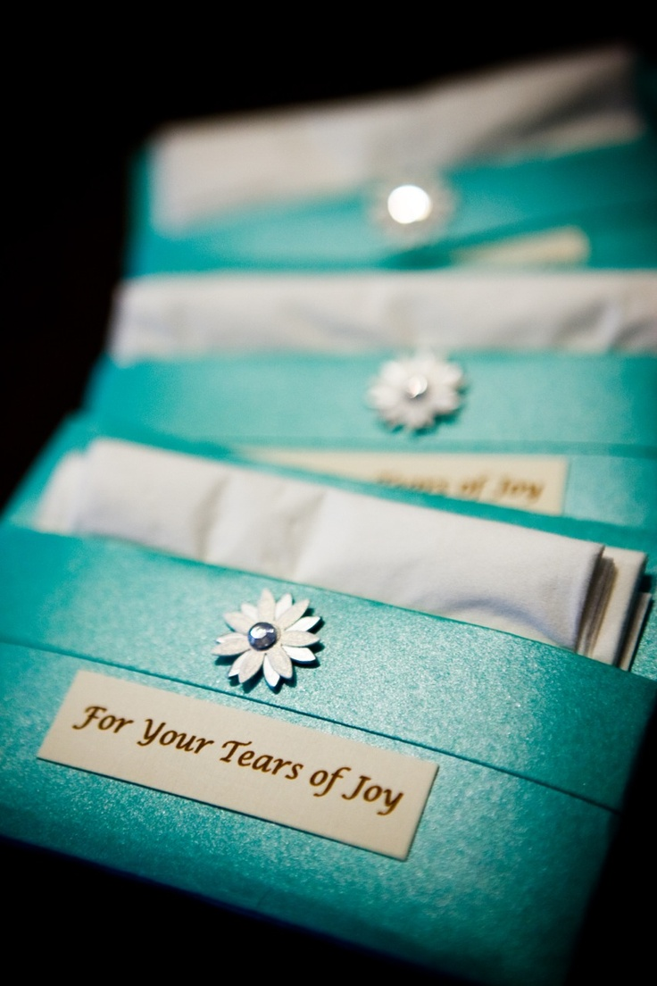 Custom Kleenex packages to hand to guests entering the ceremony.  Tears are inevitable, so save your guests' make-up w/ a thoughtful gesture that incorporates your wedding colors.