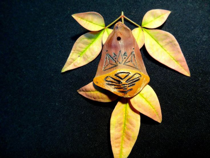 This is one of many pine cone pendants we have. can make any custom design on all of our projects