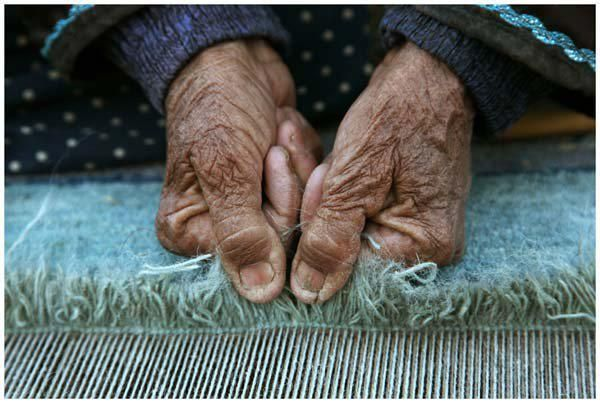How many rugs are made by these hands?