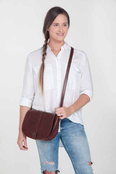 Stone waterproof lining 	Zipped inner pocket 	Zipped outer pocket 	Adjustable shoulder strap 	Magnetic clasp 	Hand crafted in South Africa 	Finest hand selected distressed bovine leather 	Available in brown & tan 	H 19cm  x W 26cm