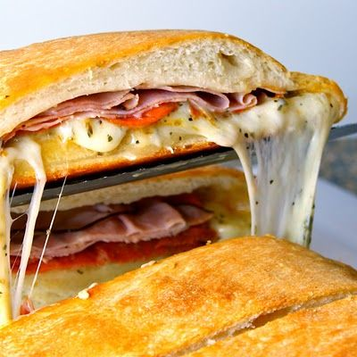 Famous Football Party Stromboli--who doesn't like stromboli? YUM. Look at that cheese oozing out. It's begging to be gobbled up:)