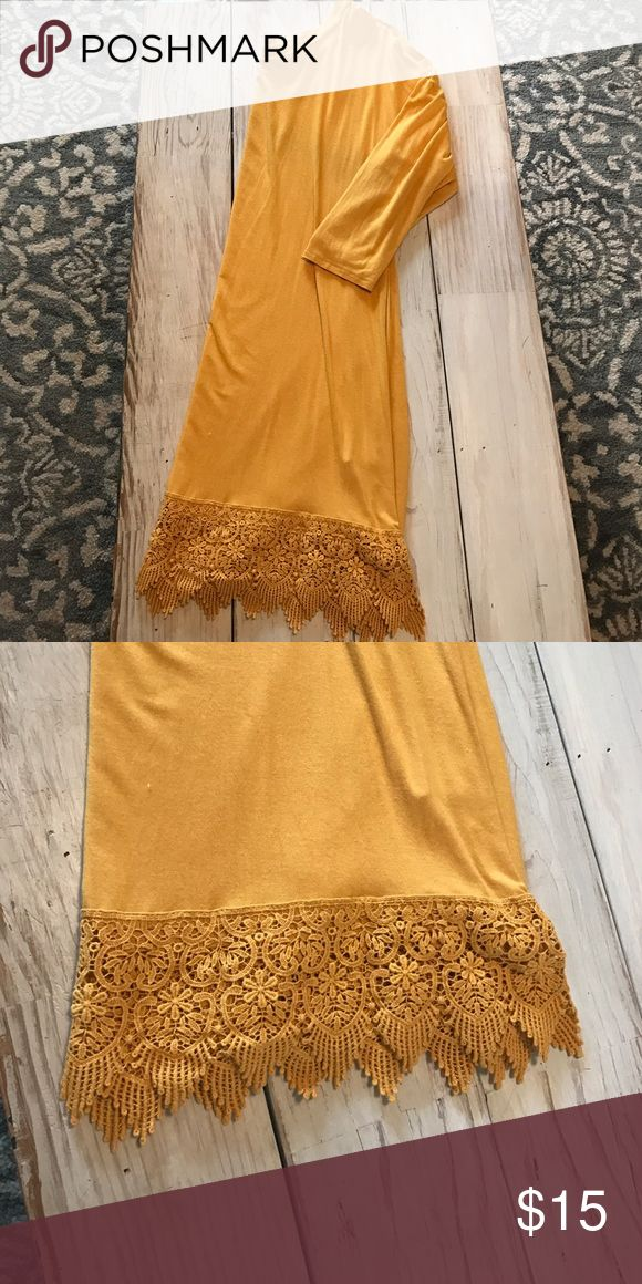 Gold three quarter length sleeve dress Worn once. This cotton gold/mustard colored dress is super comfy. I'm 5foot 4 and it hits me right above my knee. It has a cute pattern embroidery design at the bottom. Dresses Long Sleeve