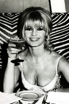 Brigitte Bardot celebrating in New York after finishing the film Viva Maria on December 19, 1965. - TownandCountryMag.com