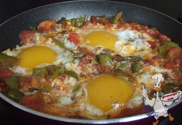 Eggs with tomatoes and peppers. The ultimate breakfast food in Turkish cuisine. You can either mix the eggs or leave them whole. | giverecipe.com | #eggs #breakfast