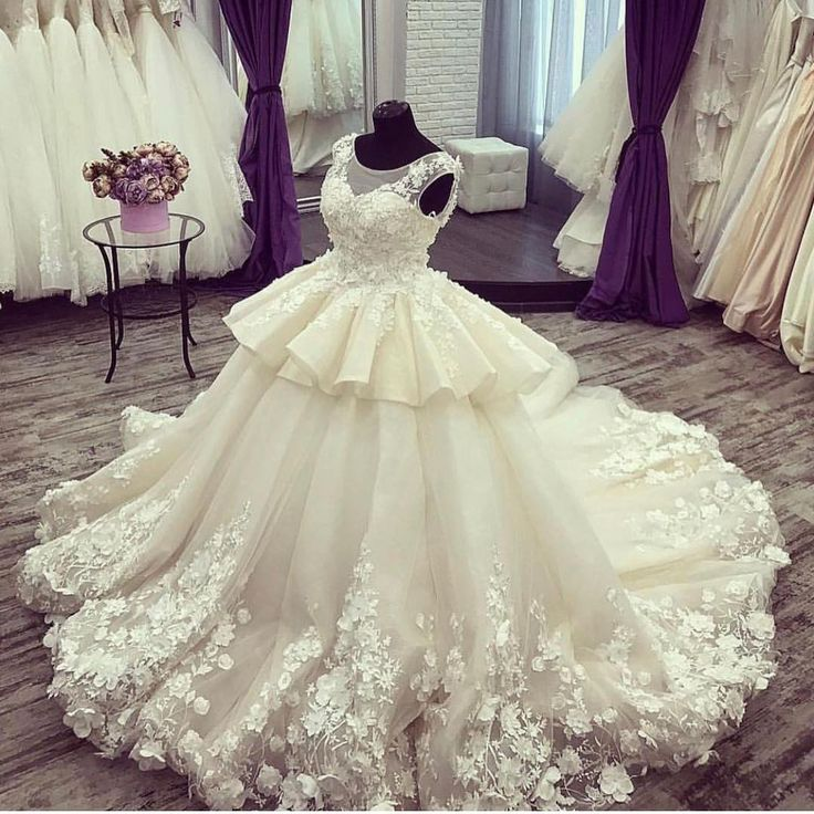 This peplum style wedding gown can be adjusted or modified to accomodate your specific body shape.  We make custom #weddingdresses for all sizes.  If your dream dress is discontinued or out of your price range we can make a #relica of the dress for you that will have teh sme style & look but for less.  Visit our main website and email us directly for pricing. DariusCordell.com