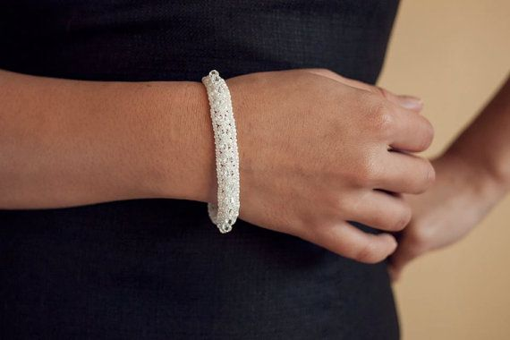 White Swarovski Crystal Beaded Kisses and bow bracelet by Shen Wong Jewellery, €65. #jewellery #fashion