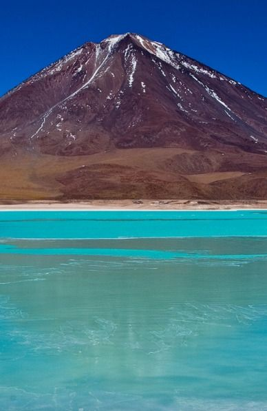 Laguna Verde, Bolivia The emerald waters of Laguna Verde front the 19,400ft volcano Licancabur, in the southwest corner of Bolivia.You've never seen water like this [65 photos] - Matador Network