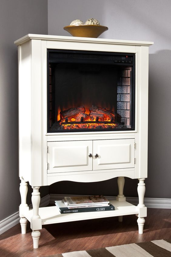 Cute idea: Fireplace set into a vintage cabinet. Hello Society
