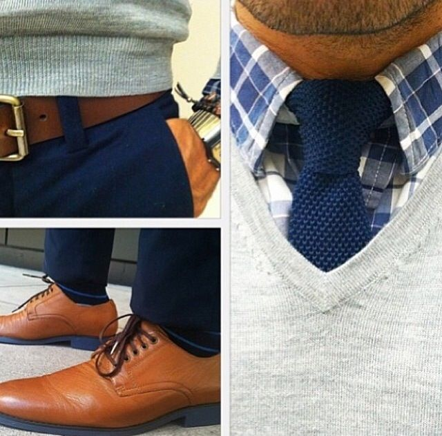 Mens gray v-neck sweater, plaid shirt, navy blue knit tie, brown leather belt, navy khaki chino pants, brown Oxford shoes great look mens fashion casual dress.