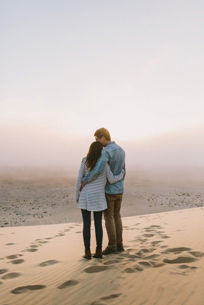 Two lovers on a dune in Swakopmund, Namibia. || www.kikitography.com