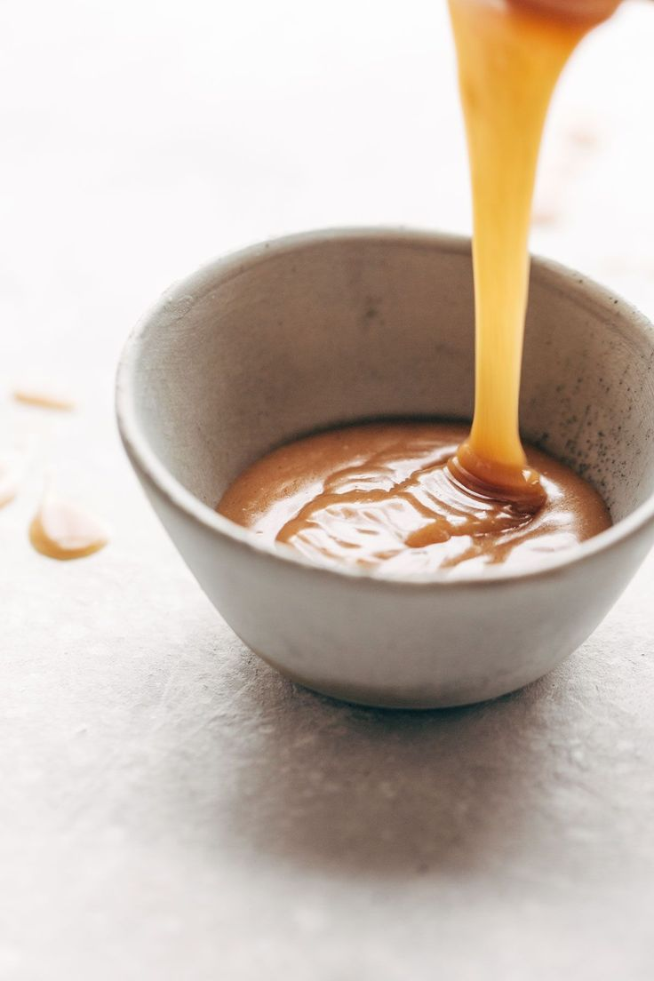 Magic Vegan Caramel Sauce made with coconut oil, real maple syrup, and almond butter. Microwave for one minute. SO GOOD! | pinchofyum.com