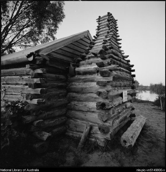 Stacey, Wes (Wesley), 1941- Chimney of log cabin at Swan Hill Folk Museum, Swan Hill, Victoria, ca. 1970 [picture]