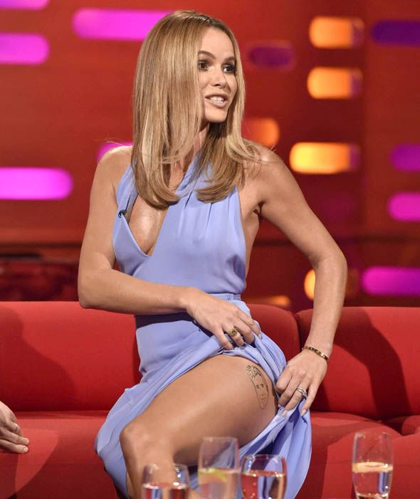 Amanda Holden showed off her toned pins and new Simon Cowell tattoo when she appeared on the show