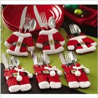 Serve your holiday dinner in style with a set of these adorable santa claus silverware holders