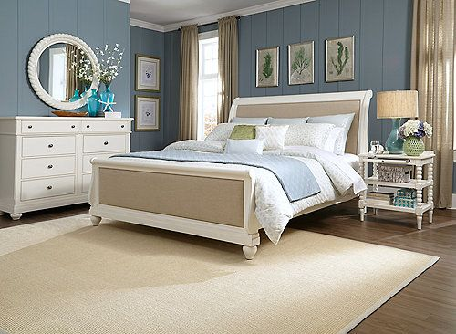 The Dinan 4-piece queen sleigh bedroom set with open nightstand and round mirror features casual cottage styling that can work from coast to coast.  Mindy veneers combine with a linen finish that work together to create an eclectic feel for today's homes.