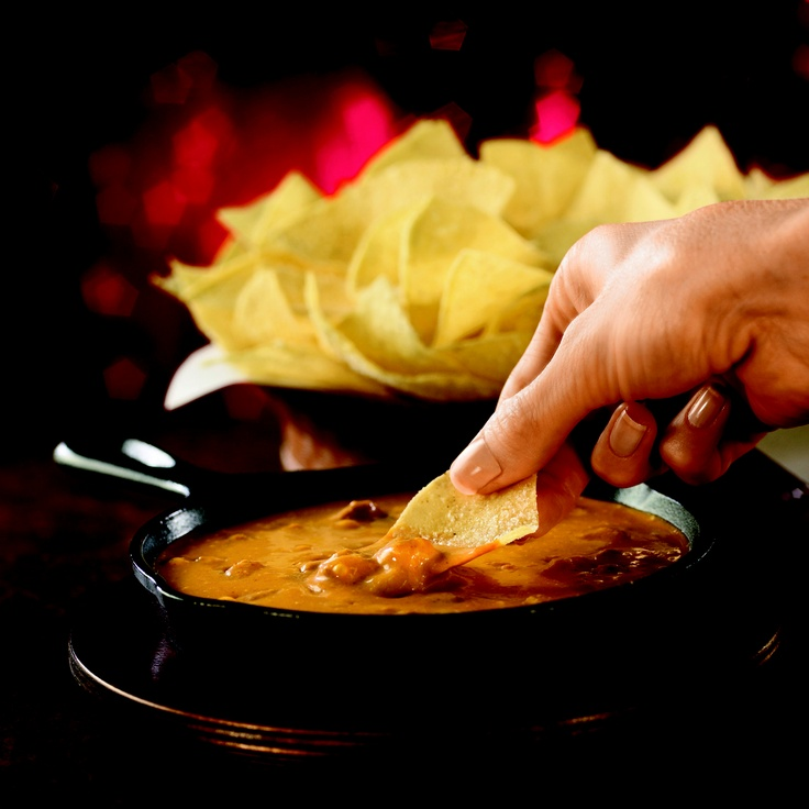 SKILLET QUESO  A Southwestern classic, seasoned cheese dip served with warm tostada chips and our house-made salsa.