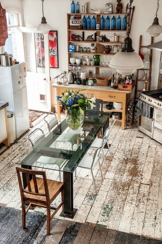 Love the rustic and modern mix .... the floor juxtaposed with the glass table!
