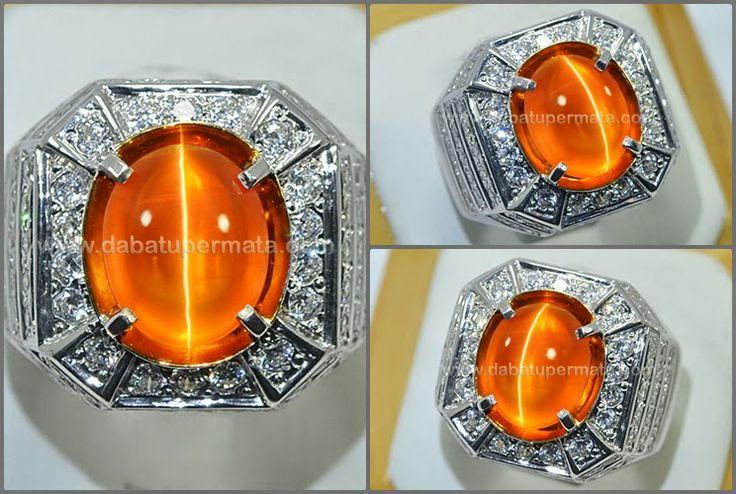 Elegant Metallic Honey Colour CAT'S EYE. Mulus - CE 121 Code:CE 121 Nama:CAT'S EYE Asal/Origin:India Berat Batu:3.6 ct Berat Total:15 gr Size/Ukuran:11.4 x 9.4 x 7 mm
