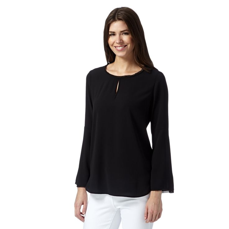 A simple top, fitted at the waist with bell sleeves.