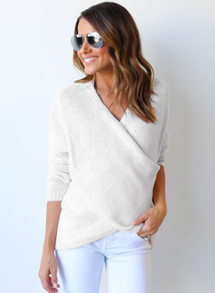 The knitted sweater is featuring v neck, pullover styling, long sleeve, irregular hemline and solid color.;Cotton and Acrylic fibers, comfortable for skin;Cross v neck, long sleeve, solid color;Suitable for casual daily wear;As different computers display