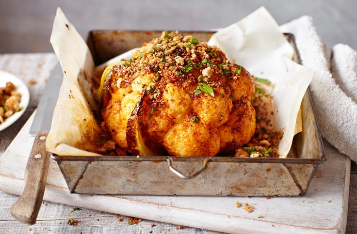 This whole roasted cauliflower is a simple vegetarian main and the perfect alternative Sunday roast. Find more Sunday lunch recipes at Tesco Real Food. Sub butter for Pure spread for vegan?