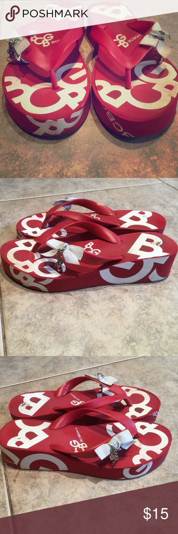 BCBG Girls Red Flip Flop With Dangle Jewelry Adorable BCBG Girls red flip flop with white letters and silver jewelry dangling from the bows. Size 7.5. Very comfortable! Shows some sign of wear. Perfect poolside shoes! BCBGirls Shoes Sandals