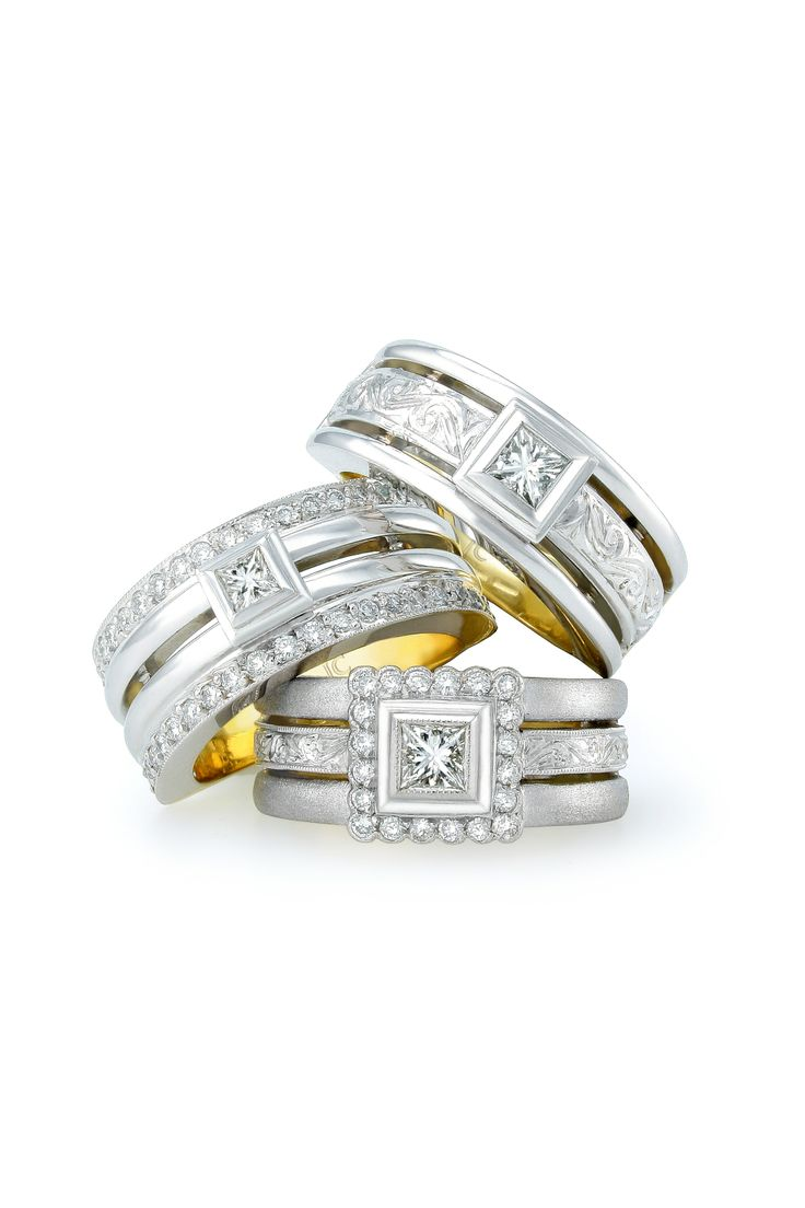 Antique engraving on the bands gives a vintage feel to these princess cut engagement rings