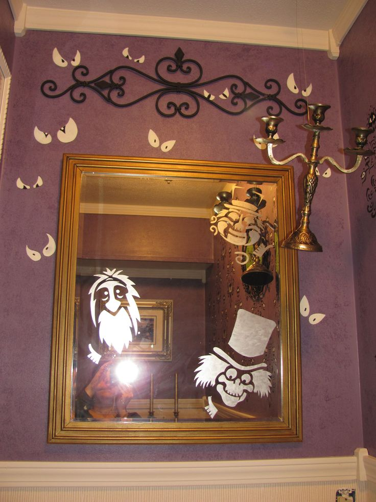 """My Haunted Mansion Bathroom.  I frosted ghosts onto the mirror, they're always looking at you!  And a """"floating"""" chandelier.  The """"spooky eyes"""" glow in the dark."""