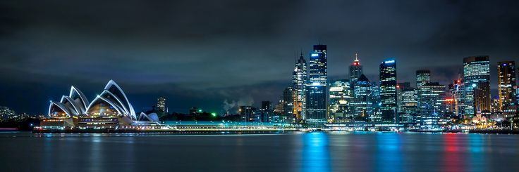 Night shot across Sydney Harbour at the Opera House and Sydney Skyline