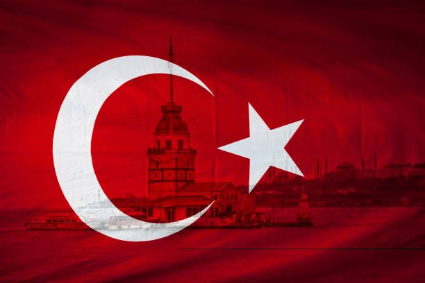 turkish flag with view of the istanbul maidens tower in backgrou