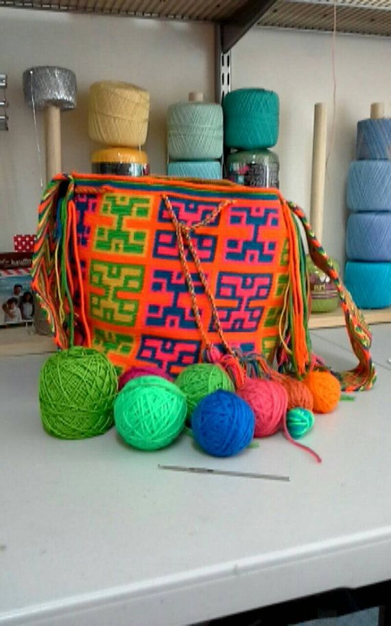 Check out this item in my Etsy shop https://www.etsy.com/listing/474711668/colombian-wayuu-mochila