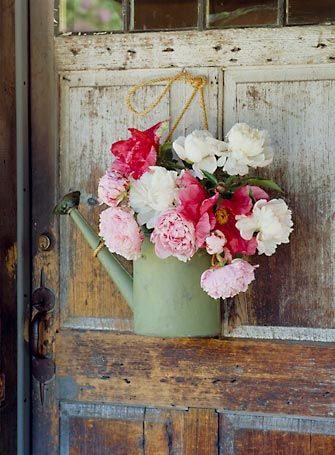 flowers. watering can.