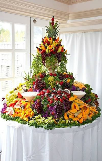 Tropical Wedding. Elegant fruit table with cascading fruit.