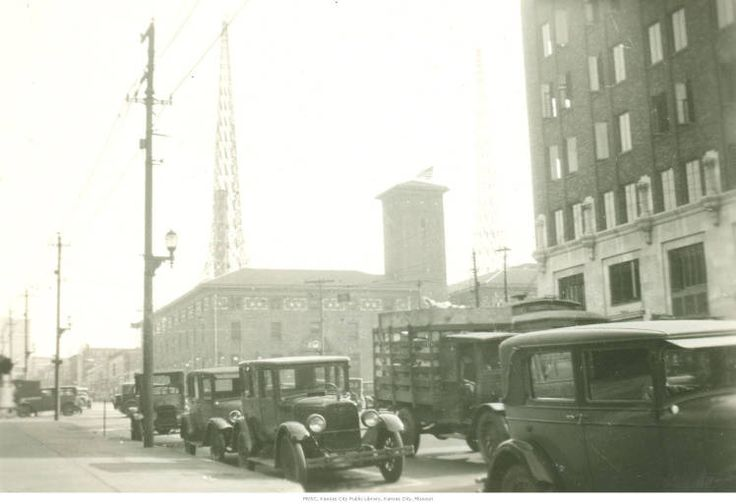 Kansas City Star  - View looking north on Grand Avenue. The Kansas City Star newspaper old  building is in view in the center, located at 18th and Grand just south of downtown Kansas City, Missouri. There are vehicles in view on Grand Avenue and the WDAF radio towers are visible on top of the Star building. Date1928