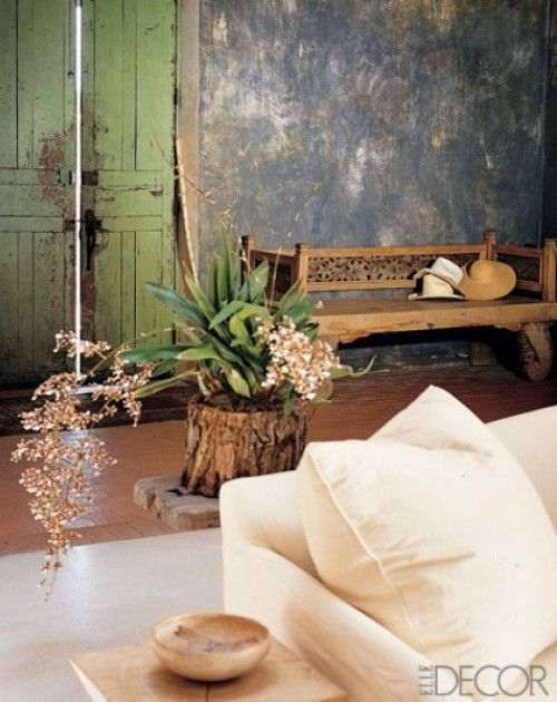 Outdoor Inspired Decor - a tree stump in the middle if the living room?  May be wierd to some prople but, I just love it! And, the aged green door? Be still my heart!