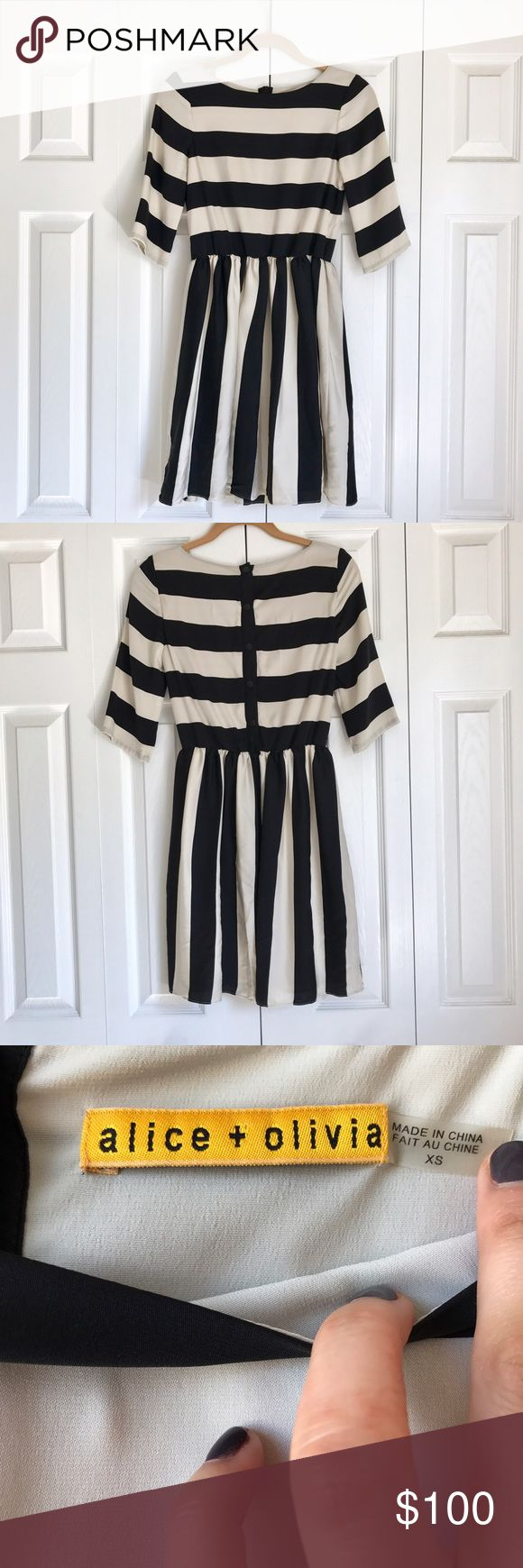 Alice + Olivia black and white dress Alice + Olivia black and white striped dress with button up back. Beautiful dress for any occasion, formal or casual. Missing the sash for around the waist but still looks amazing without it. Looks great with black stockings and black pumps. Alice + Olivia Dresses