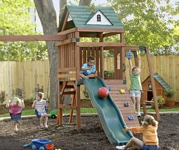 a cedar playset offers endless for swinging sliding and climbing while rubber mulch provides a soft landing spot even the family pet is