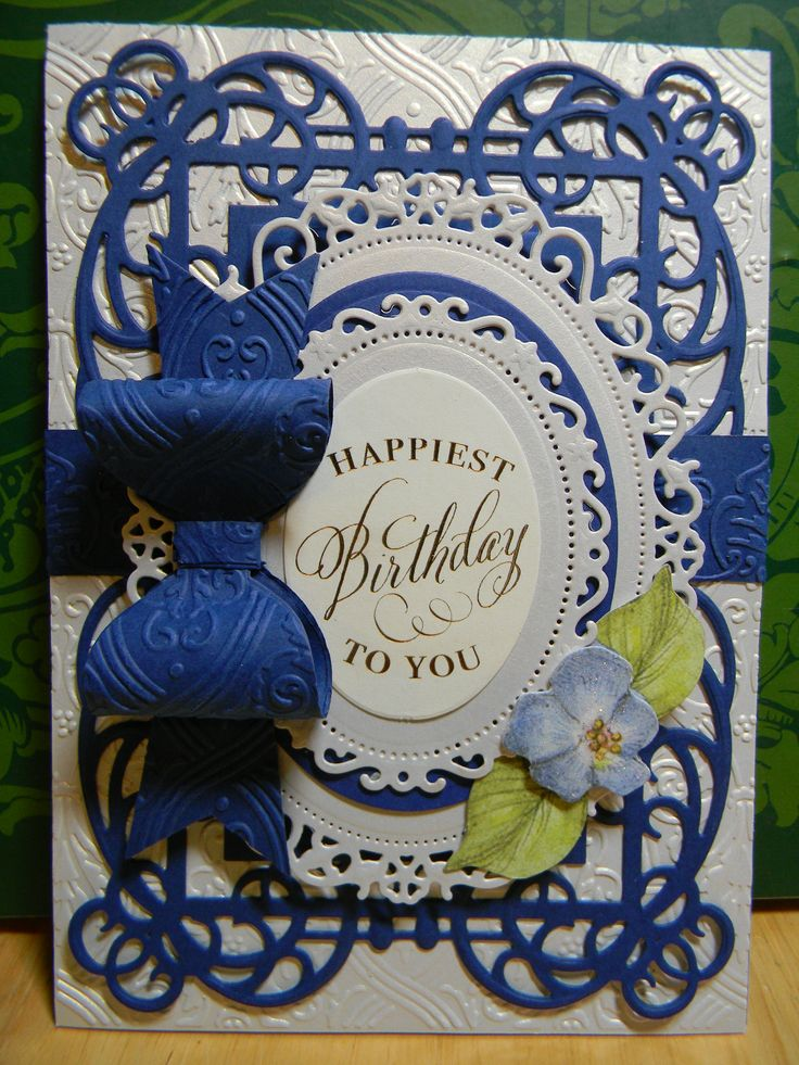 Metallic Hues Cardstock, Pirouette Embossing Folder Set, Bow Die and Sentiment all from Anna Griffin, Inc.  Dies from Spellbinders.  Flowers from K & Company.