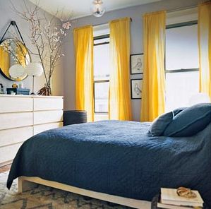 Perfect for the bedroom! I am in love with these yellow curtains and the delicate flower accents