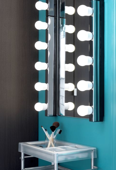 Brighten up your bathroom routine with the fashion forward MUSIK wall lamp.