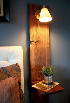 floating nightstands with bedside lamp save space and it's an easy, inexpensive DIY