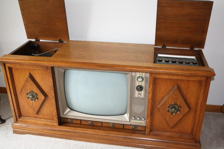 The beautiful Curtis Mathes console stereo with a deluxe AM/FM radio, turntable and a television in the center.