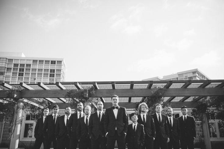 The groom and groomsmen looked dapper in black for this Coronado Summer Wedding. #coronadowedding #weddinginspiration #groom #groomstyle #weddingphotography #groomsmen