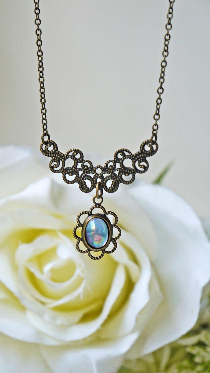 Vintage Light Sapphire Blue Glass Cabochon Necklace. Aurora Borealis. Antique Brass. Romantic