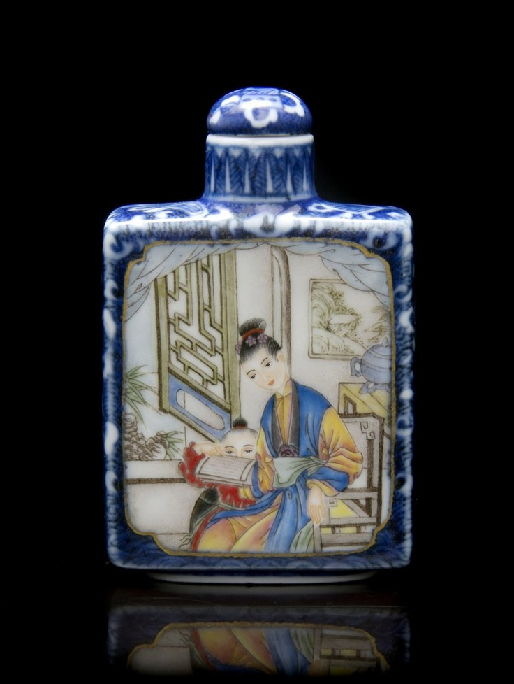 A Polychrome Enameled Porcelain Snuff Bottle,  of squared form, having cartouche form figural reserves over a blue and white ground, with gilt accents.